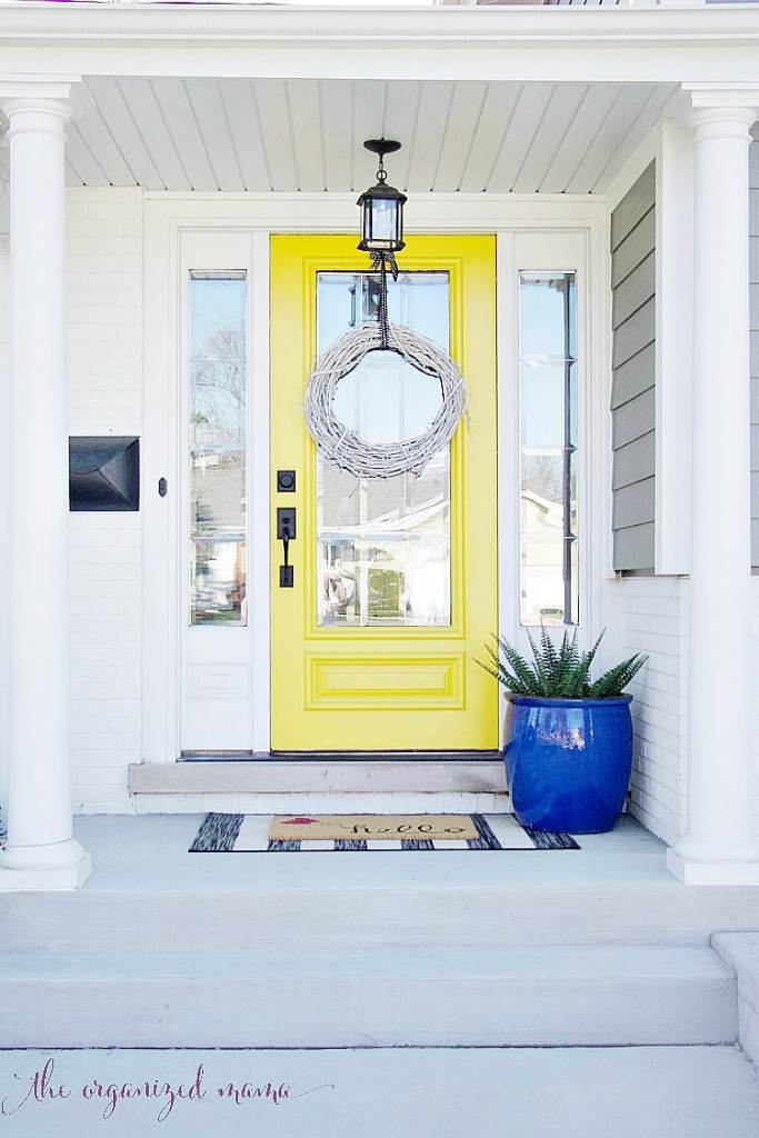 These easy tips will help you add spring to your entryway decor. Plus you can easily add these tips to apply to any room in the house to get your home cozy and ready for spring! #spring #entryway #decor