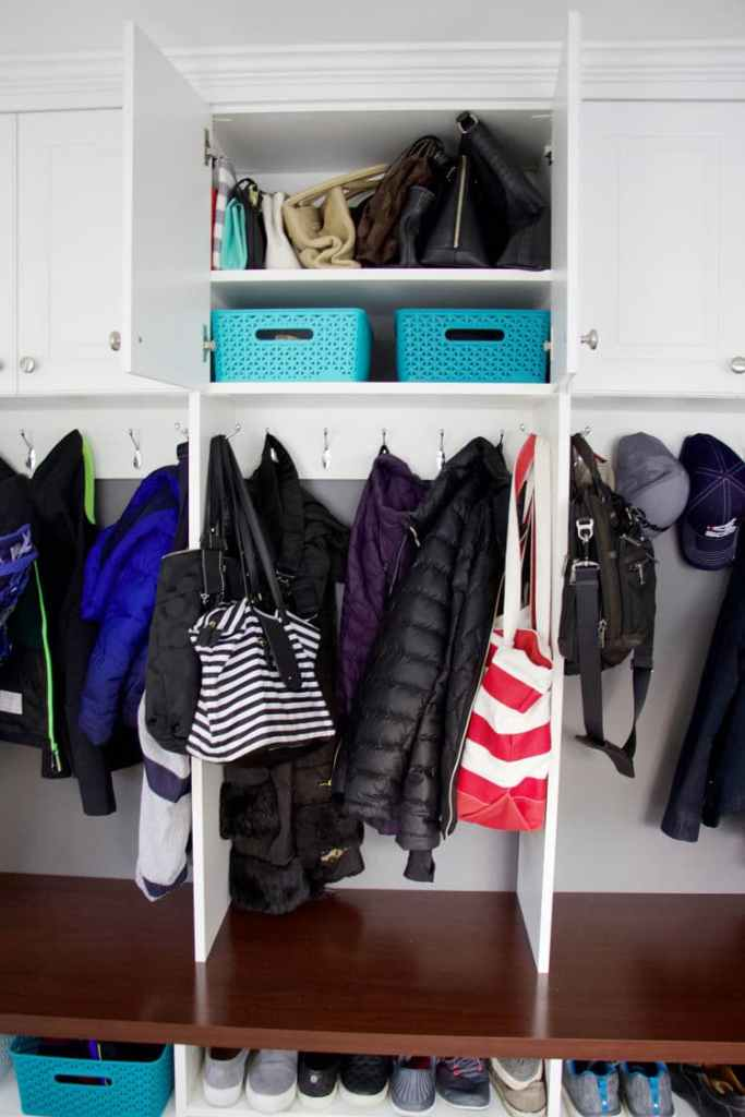 Learn how to create mudroom storage from professional organizers, The Organized Mama. With countless years of experience, she has tips for any space. #mudroomstorage #mudroom