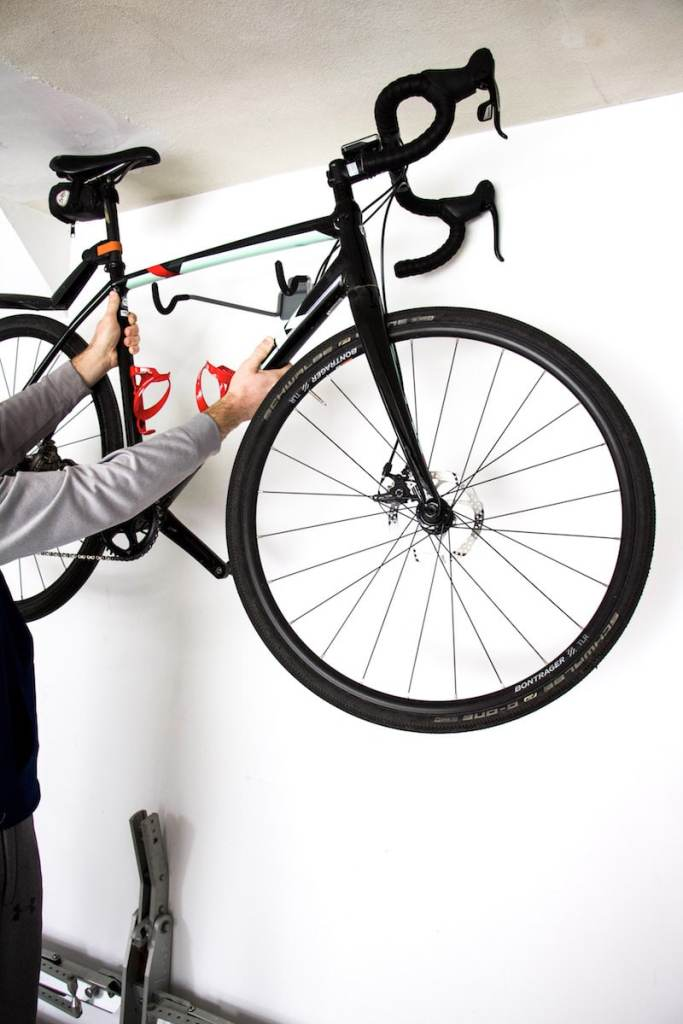 Professional Organizer shares tips on how to utilize space to create garage bike storage that won't break the bank. Plus ideas for bike supply organization. #garageorganization #bikestorage