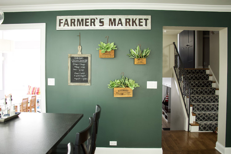 Farmer's Market Sign against moody green walls and boxed planters with faux succulent plants inside. #farmhousedecor #modernfarmhouse #kitchen