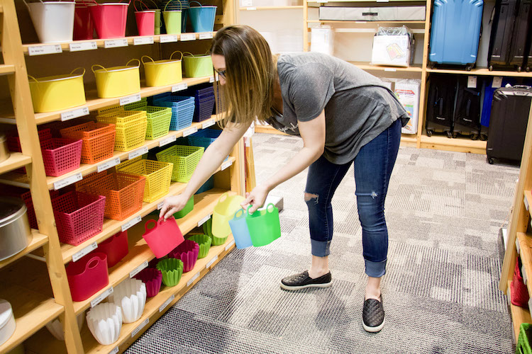 Professional organizer shopping at the container store in the party aisle to find containers for tiny toys like shopkins characters and hachibabies
