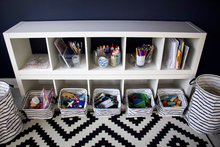 toys in bins and art supplies organized to demonstrate how to minimize kids toys