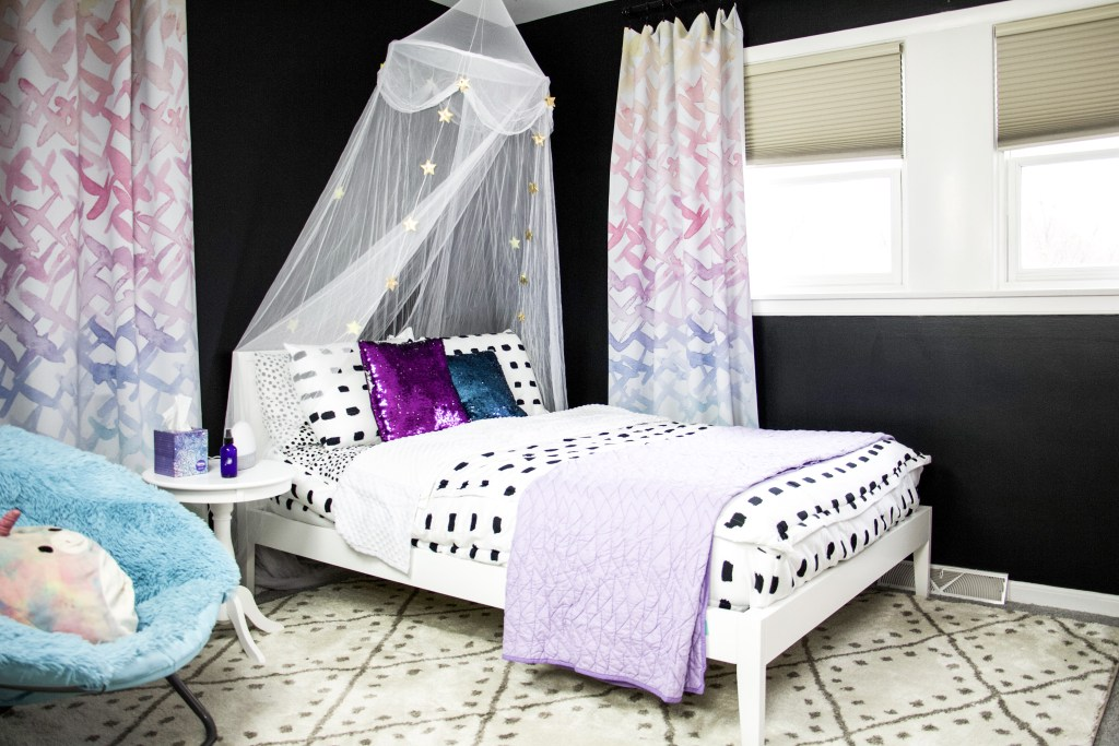 black satin paint with white bed in front of windows