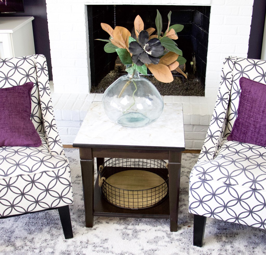 chairs and end table with marble top