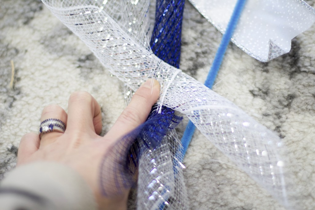 roll three pieces of deco mesh together for hanukkah decorations