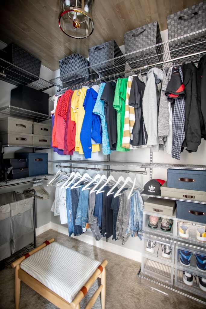 Final closet with colorful shirts hanging from Just Destiny