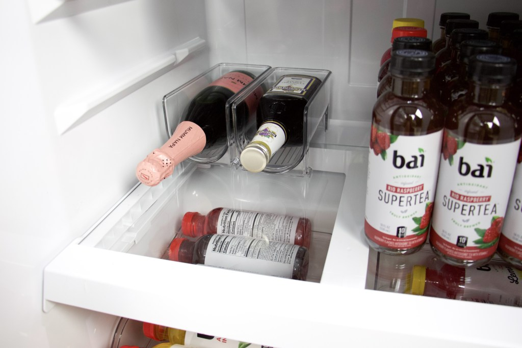 close up of wine holders in beverage fridge