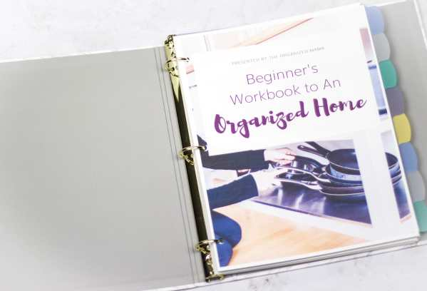 close up of binder version of organized home workbook with tabs