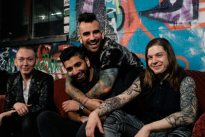 A War Within band sitting down for press shot