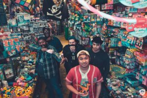 Action/Adventure band picture being crazy in a supermarket