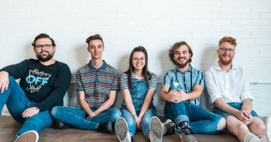 Vasco band press image band sitting down and smiling