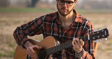 James Meadow singing with guitar