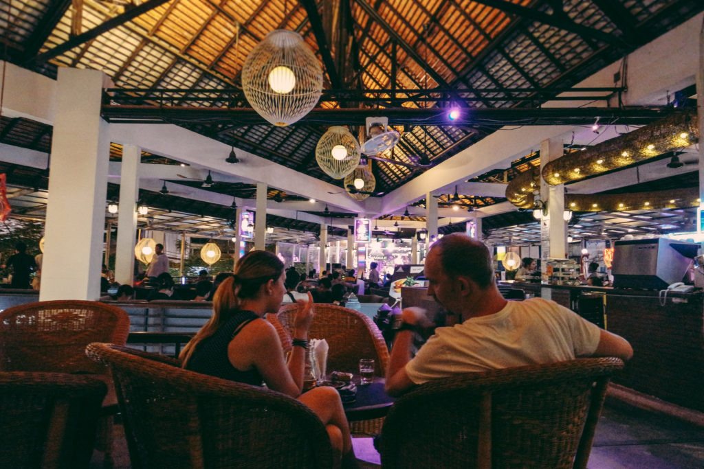 couple drinking in the bar in siem reap