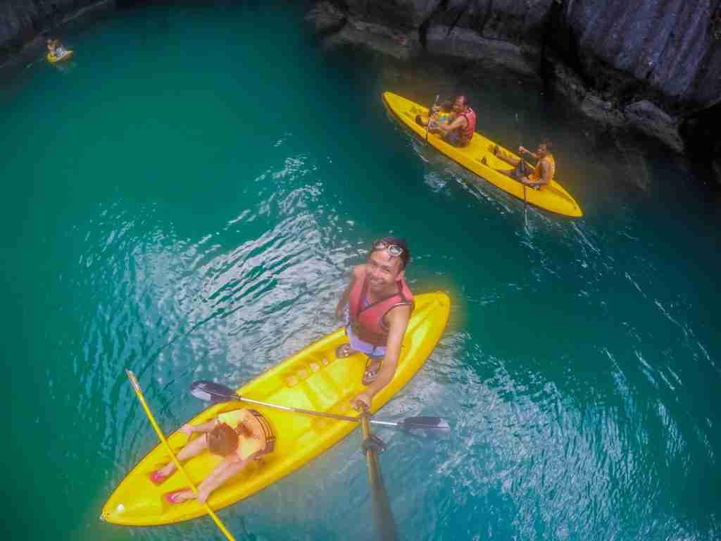 standing in kayak boat in el nido
