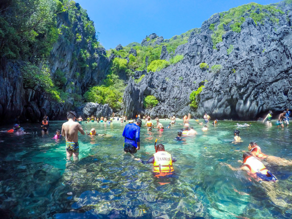 secret beach el nido palawan rocks and crowd