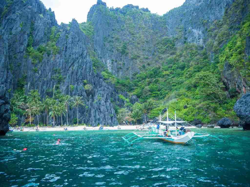 secret lagoon shore with boat