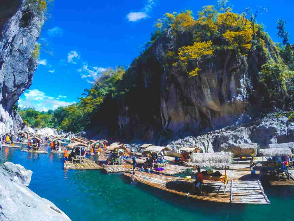 huge limestone rock formations and bamboo rafts in minalungao national park