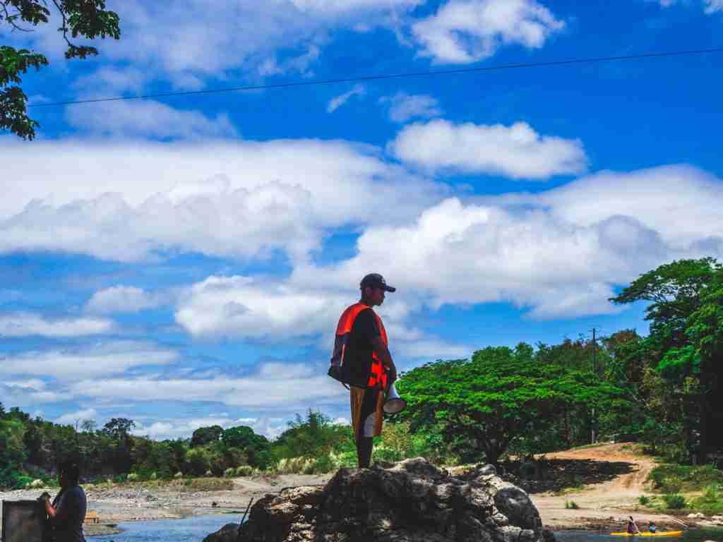 Lifeguard with megaphone watching in minalungao national park