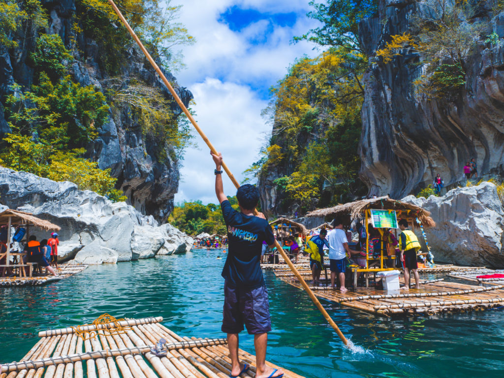 man rafting in sumacbao river in minalungao national park