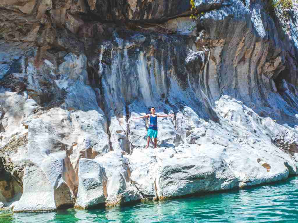 cliff diving in sumacbao river from the rock fomration in minalungao