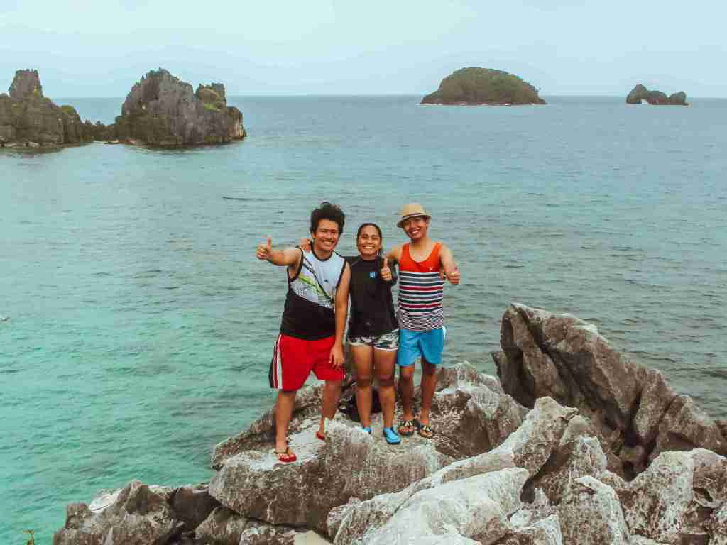 rock climbing in the rock formation of matukad island in caramoan