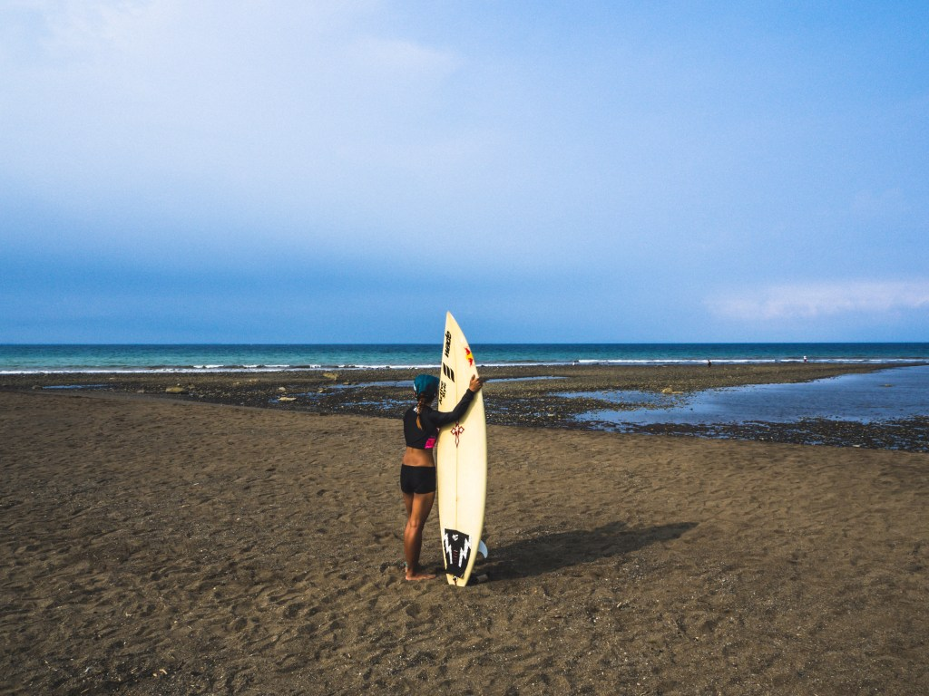 picture with surf board in magra beach in real quezon