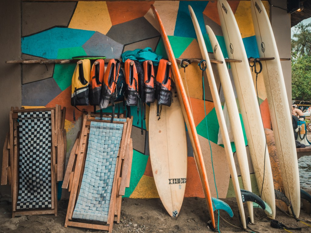 real coast and surf resort in quezon with surf boards, life vests, and folding chair