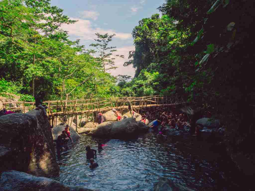 People enjoying their swim in the fresh and cold waters from Tanawan Falls