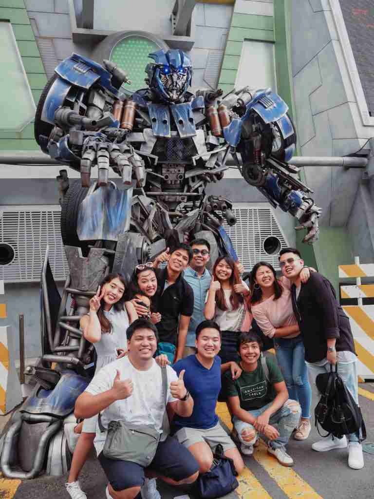 group of friends picture with optimus prime in universal studios singapore