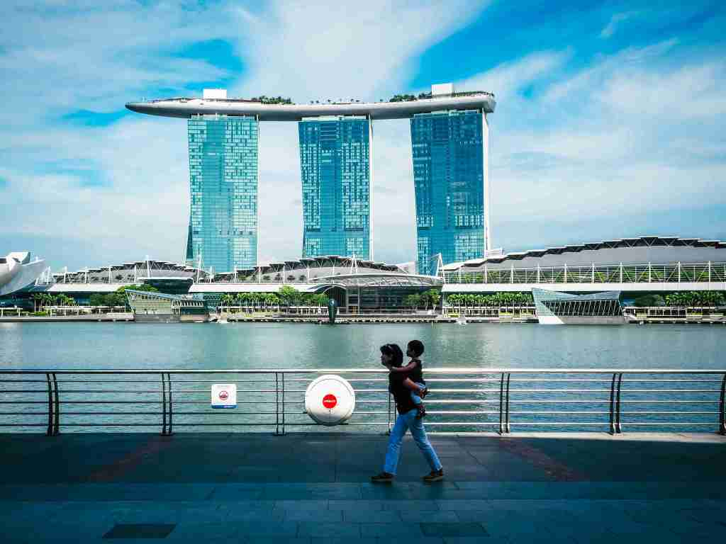 mother and son walking in the merlion park