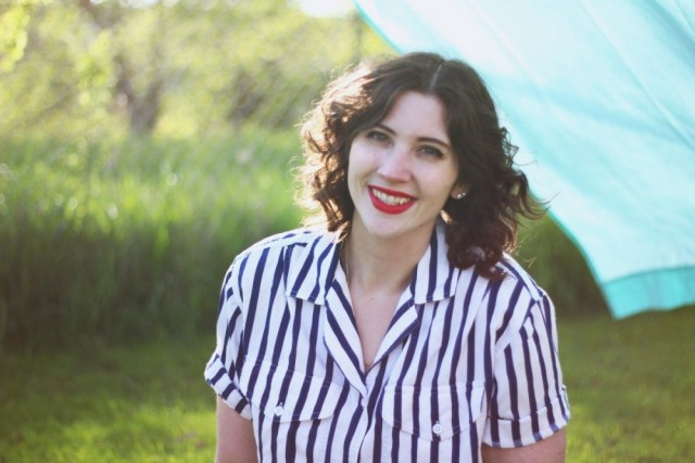 Outfit mixing striped shirt and polka dotted shorts. Sunny outdoor photos with a bed sheet!