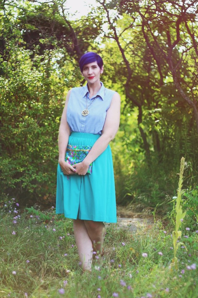Outfit: Sleeveless chambray blouse, teal skirt, printed vintage clutch, purple pixie cut