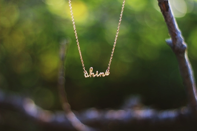 """Dainty gold necklace that says """"shine"""""""