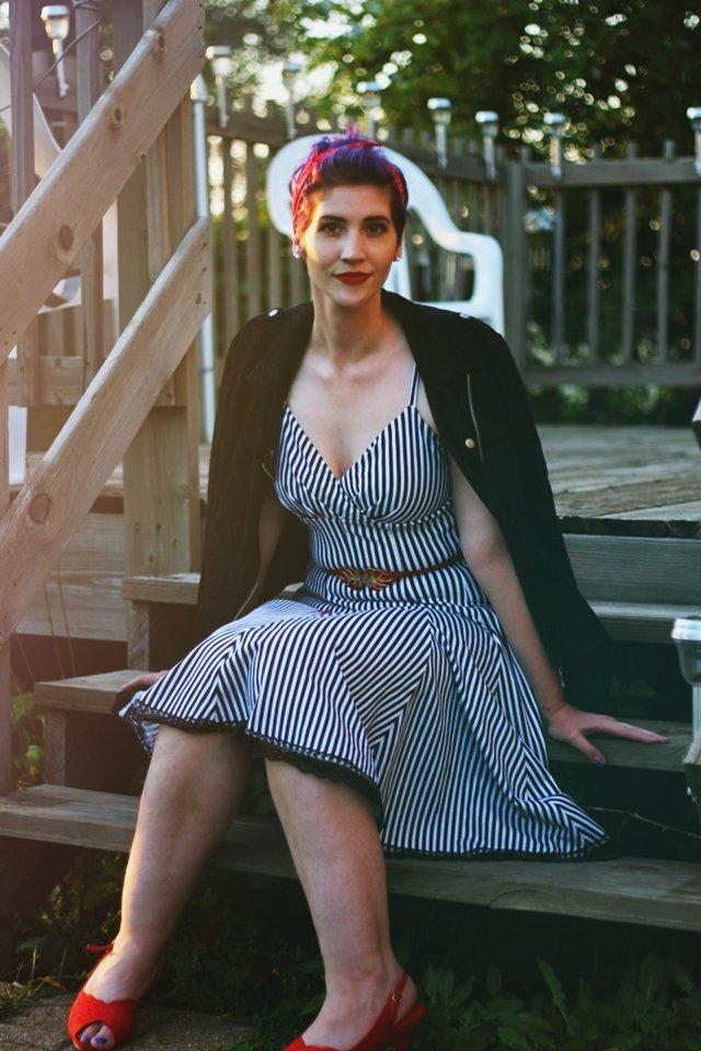 Outfit: Striped retro style dress, black moto jacket, red kitten heels, vintage red belt, red bandana, purple pixie cut