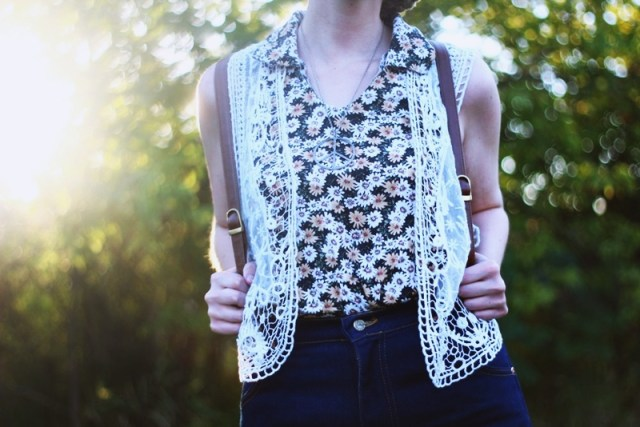1970s Inspired Outfit: Floral blouse, white lace vest, high waisted dark wash denim,
