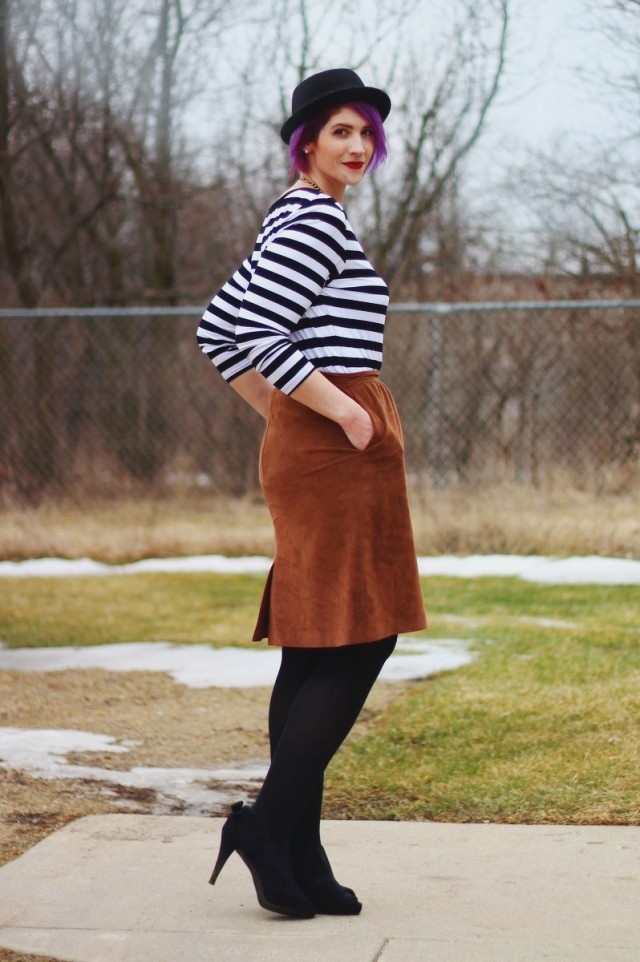 Outfit: striped top, brown suede skirt, statement necklace, black heeled booties, red lip, black pork pie hat, purple hair