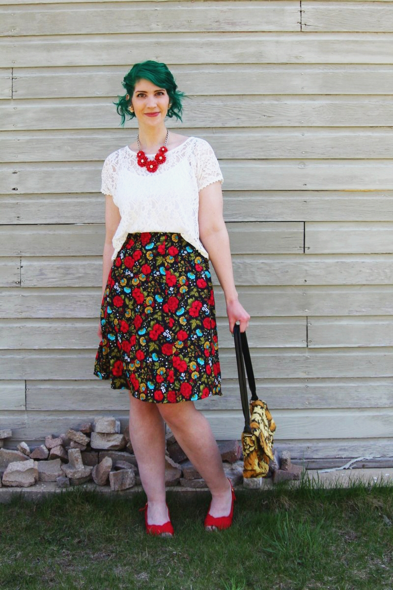 Spring style outfit: Target white lace crop top, vintage thrifted red floral skirt, thrift yellow carpet bag, red flower necklace, Punky Colours green hair, vintage red kitten heels pattern mixing