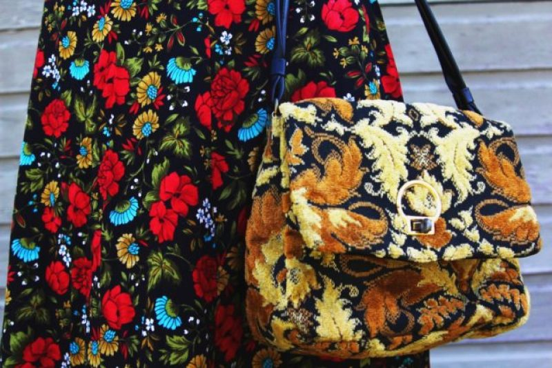 Spring style outfit: vintage thrifted red floral skirt, thrift yellow carpet bag pattern mixing