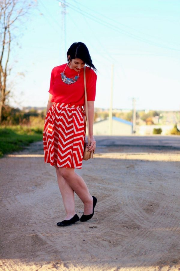 Outfit: Vintage red top, DIY puzzle piece necklace, red lipstick, thrifted orange chevron skirt, beige cross body purse, black flat shoes.