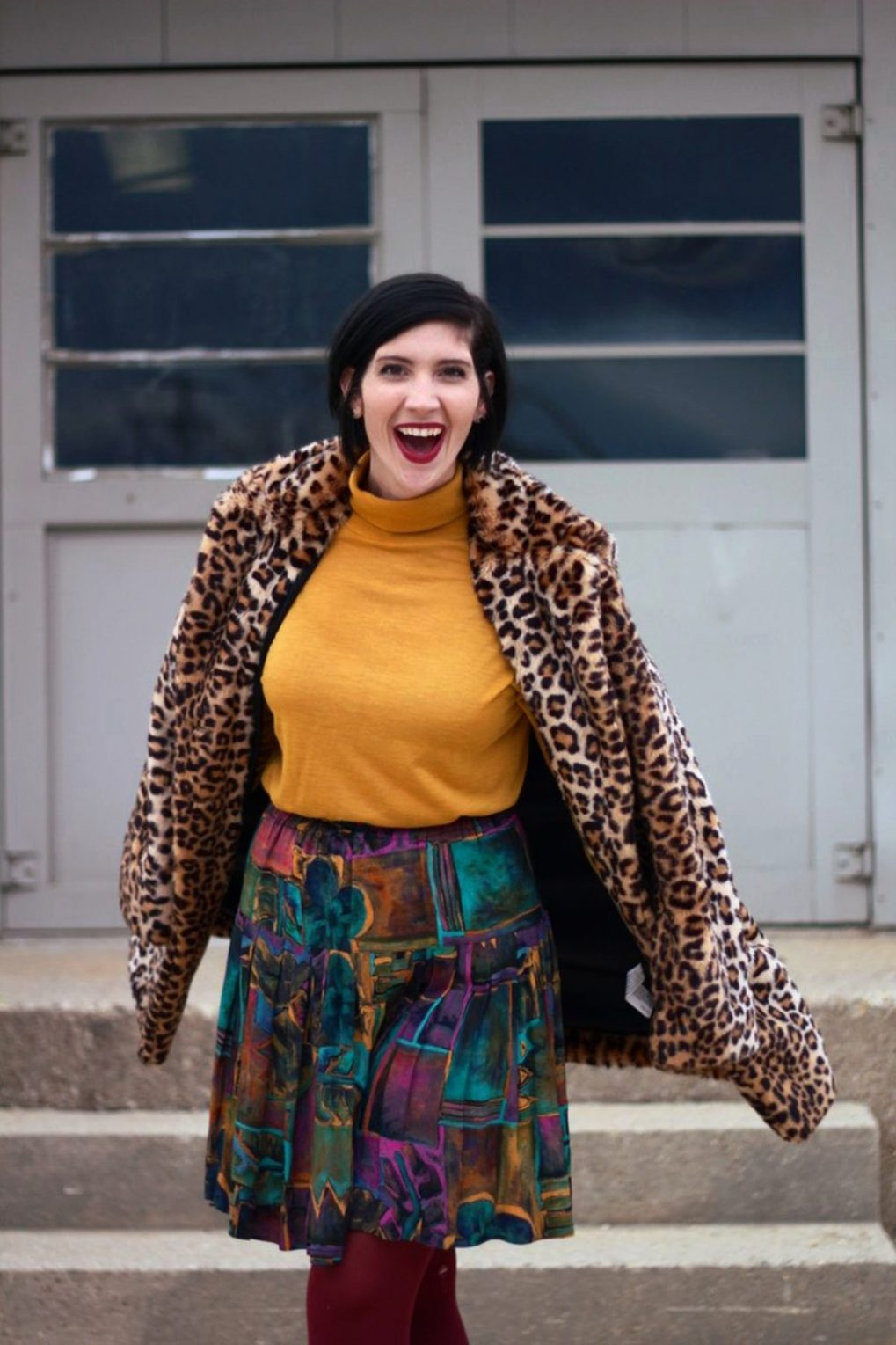 Outfit: Leopard print coat, mustard yellow turtleneck, multi colored skirt