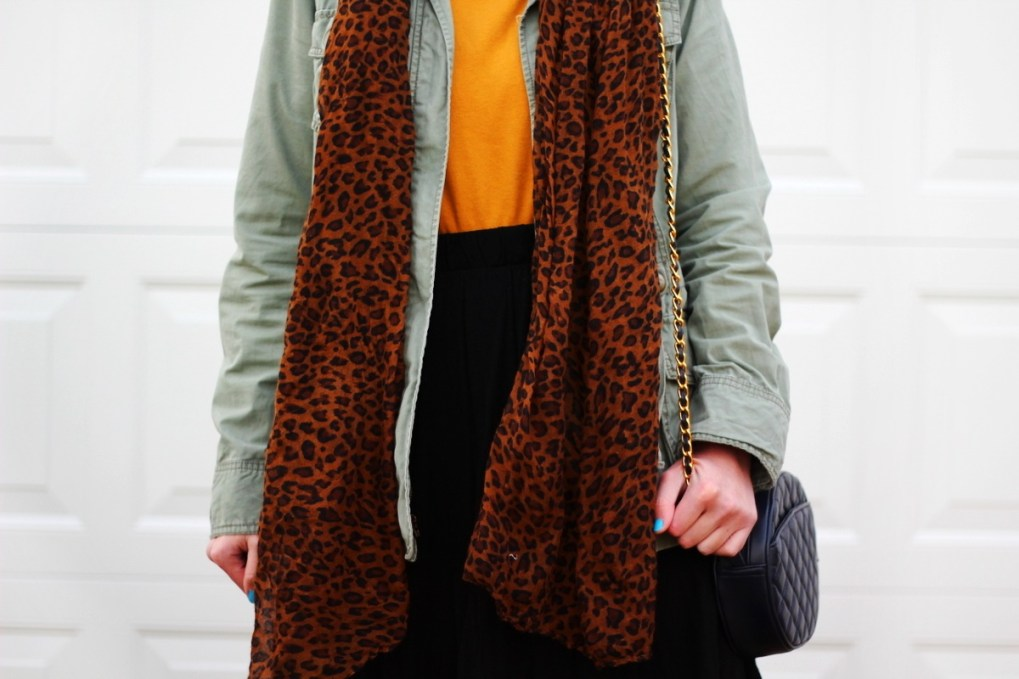 Outfit: mustard yellow turtleneck, olive green utility jacket, leopard print scarf, black skater skirt,navy blue quilted purse