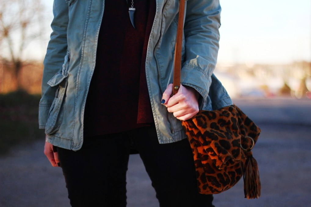 Outfit: burgundy top, olive colored jacket, black jeans, leopard print cross body purse