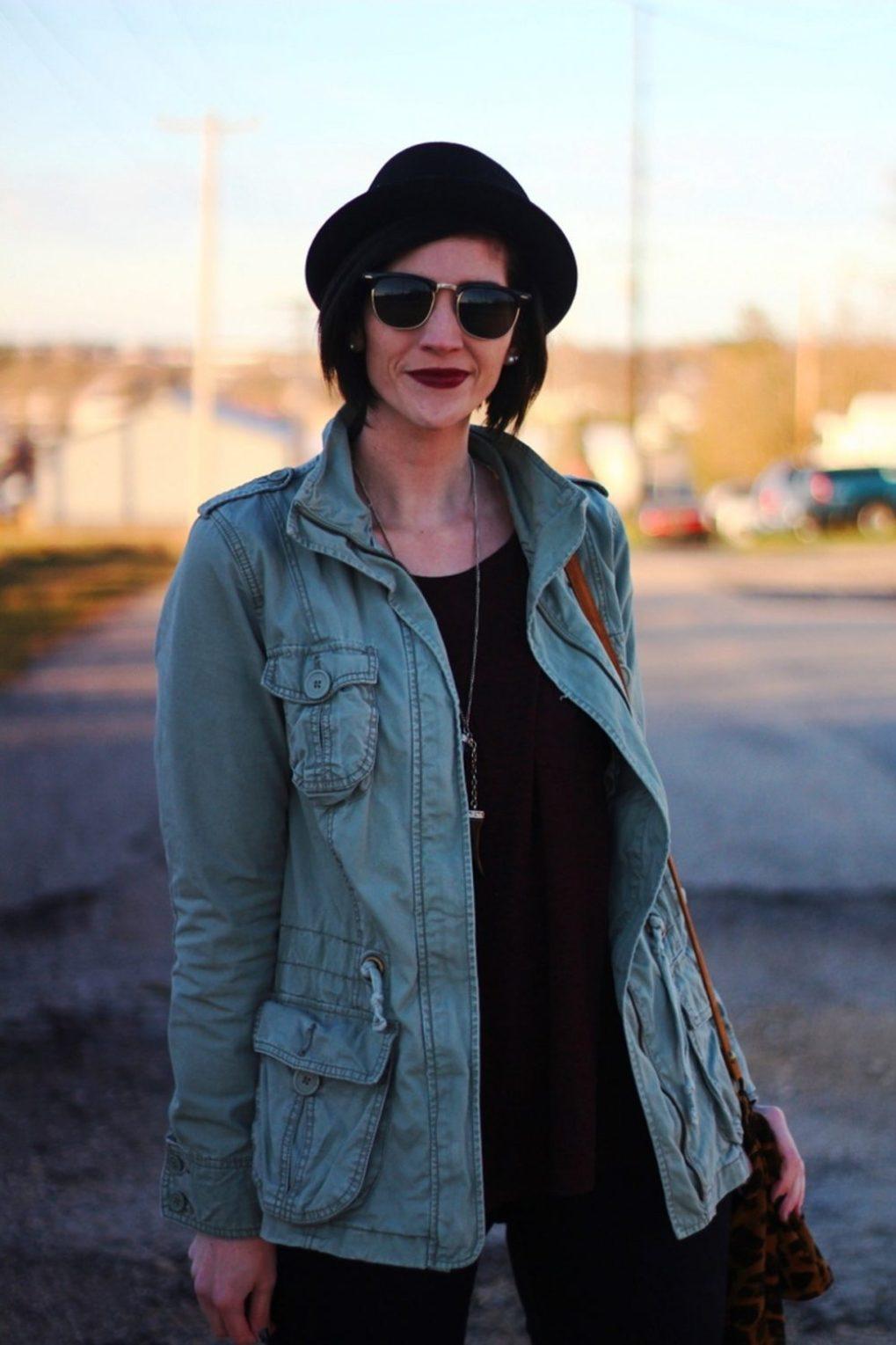 Outfit: burgundy top, burgundy lipstick, olive colored jacket, black sunglasses, pork pie hat
