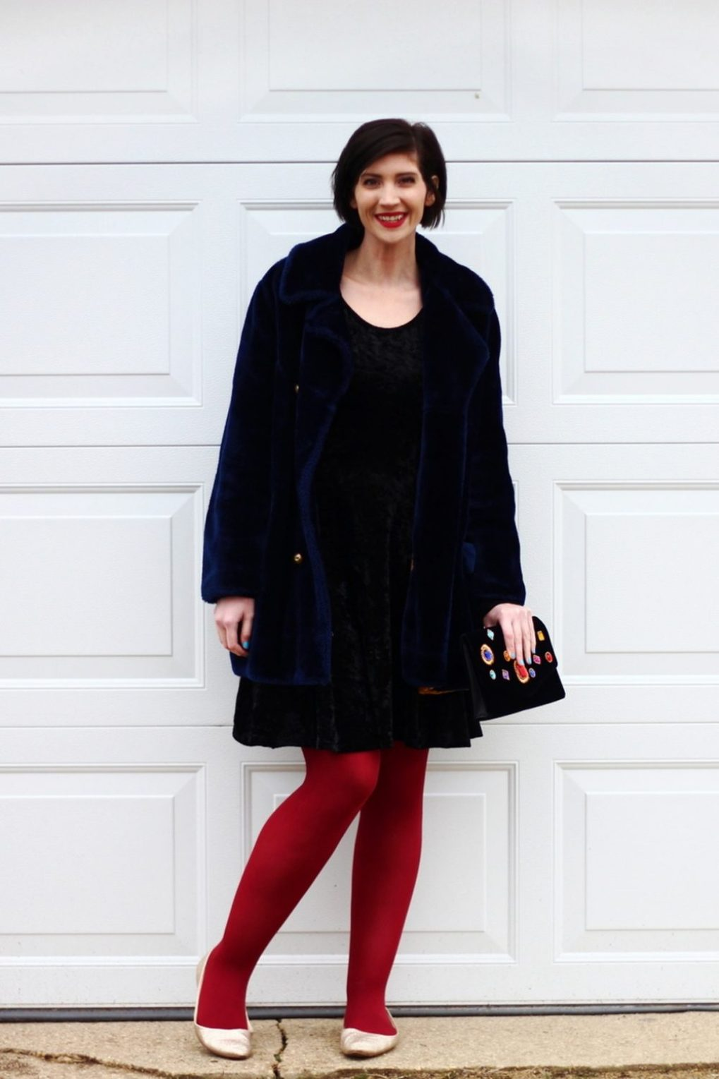 Outfit: little black dress, faux fur navy blue coat, dark red tights, embellished clutch, gold glitter flats