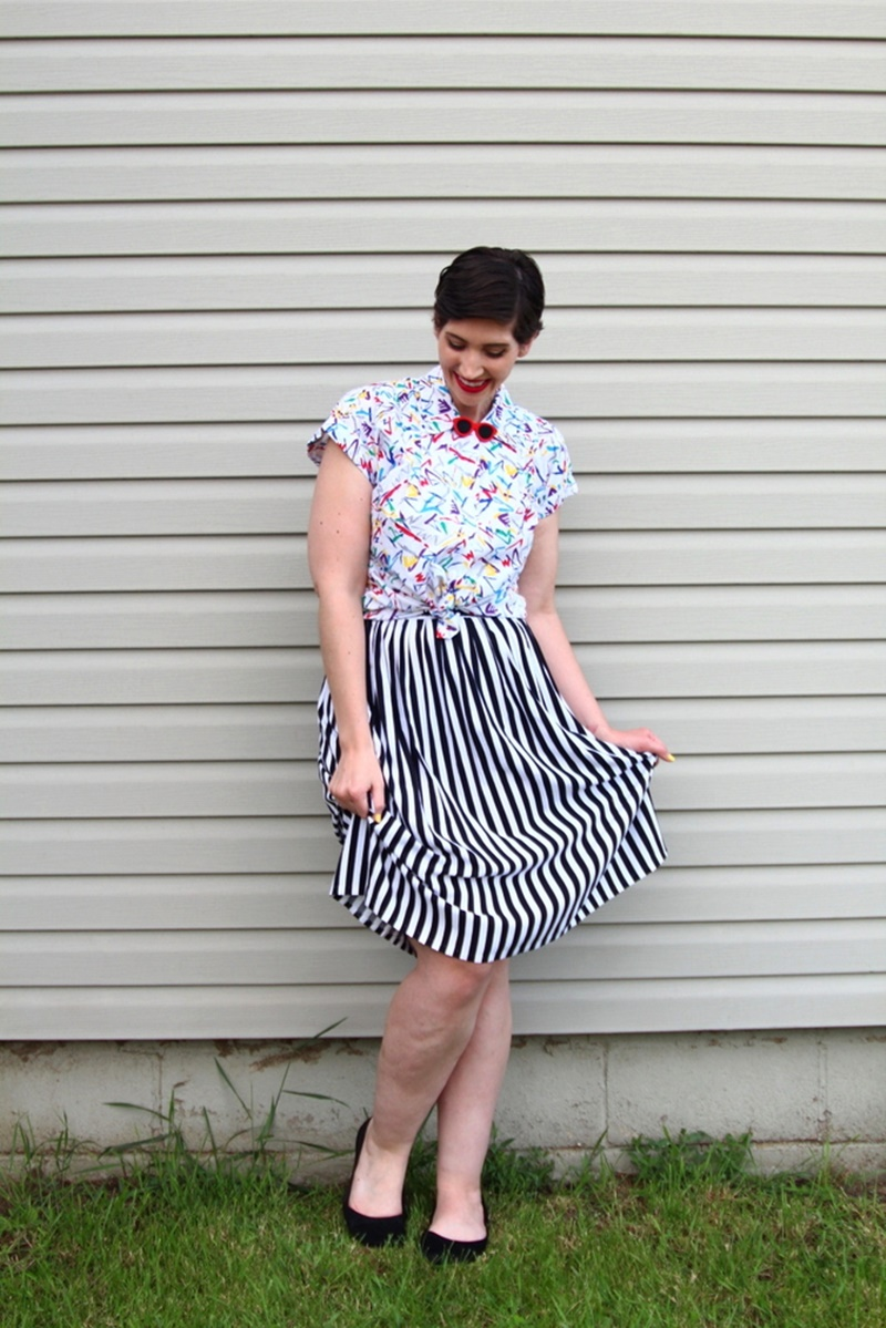 Memorial day outfit, thrifted black and white striped skirt, vintage abstract printed button up, Colourpop lippie stix Bossy red, black Walmart flats, 1980s sunglasses lapel pin