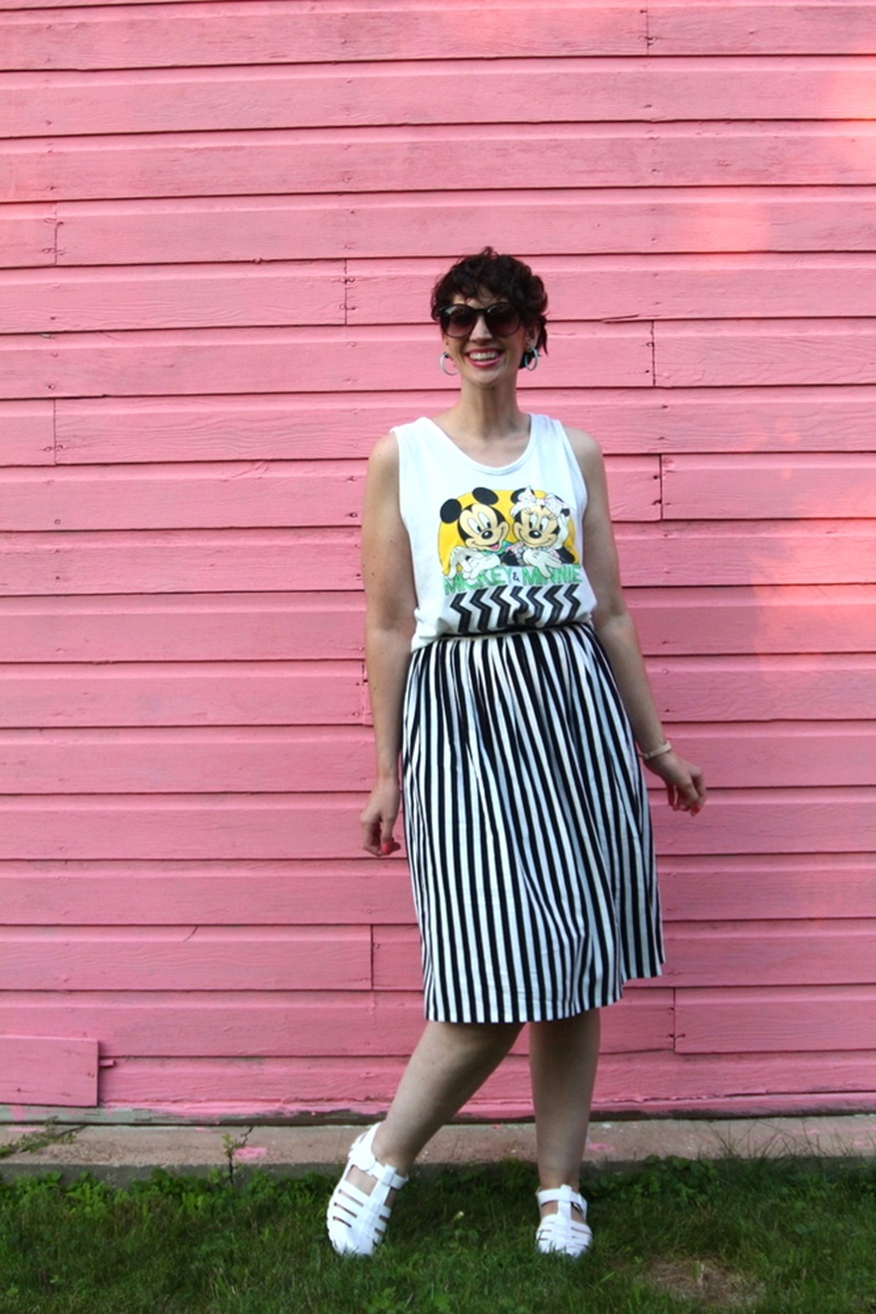 1980s outfit post striped skirt, mickey and minnie tank top, vintage sunglasses, jelly sandals, retro earrings