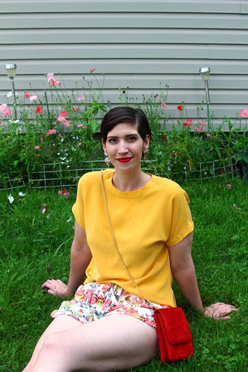 outfit detail floral shorts summer, yellow blouse, red purse, colourpop bossy lippie stix, pixie hair cut, lulus white sandals