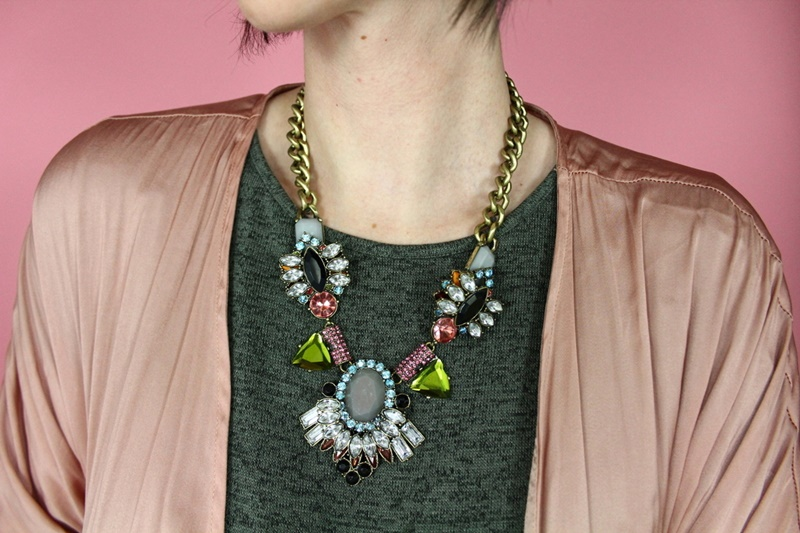 valentine's day outfit hannah rupp green dress, pink kimono, and huge rhinestone statement necklace
