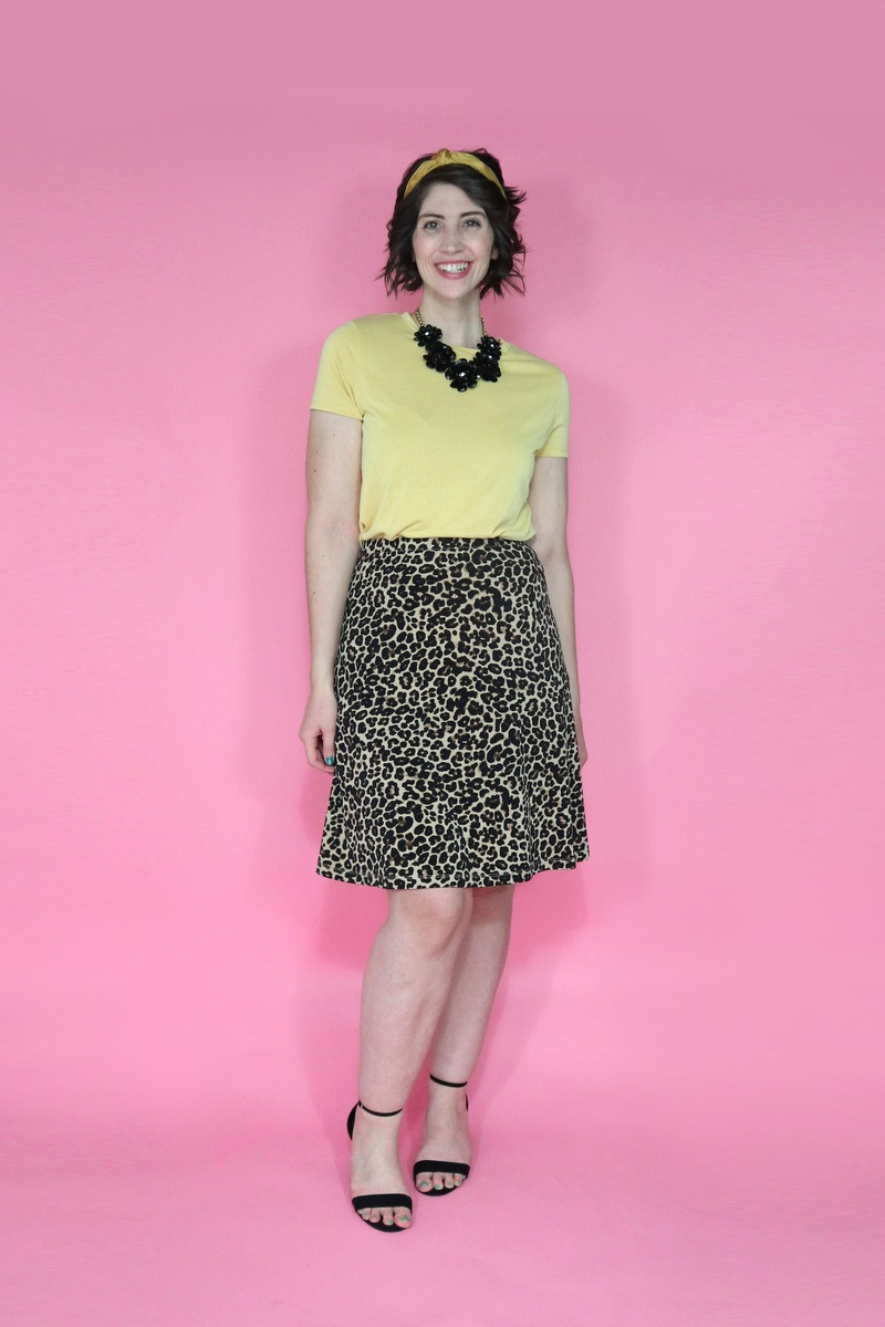 best thrifted clothes yellow tee leopard print skirt black high heels outfit