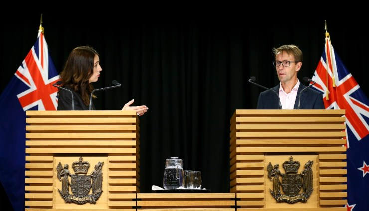 Prime Minister Jacinda Ardern and Director General of Health Ashley Bloomfield speaking at a press conference in August